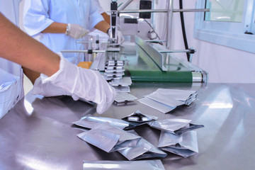 Pharmaceutics. Pharmaceutical worker operates Drug Packaging Process