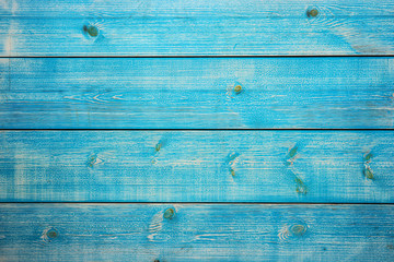 Old painted blue colored wooden background for your design