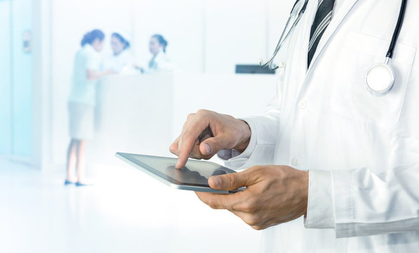 Smart health care internet of things and hospital automation management technology concept with paperless. Doctor with Stethoscope using tablet for check status of patient.