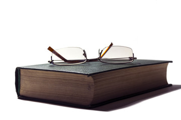 Glasses on the book