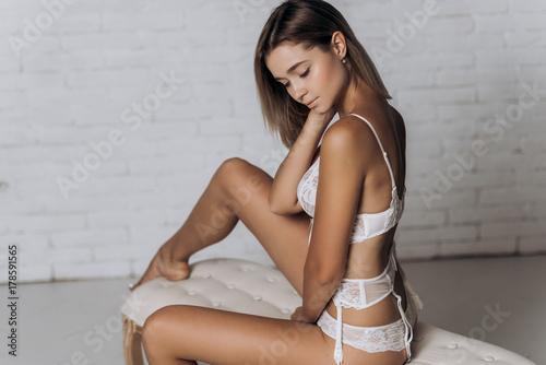 865f92c5b Sexy woman in underwear posing. Beautiful girl in white wedding lingerie.
