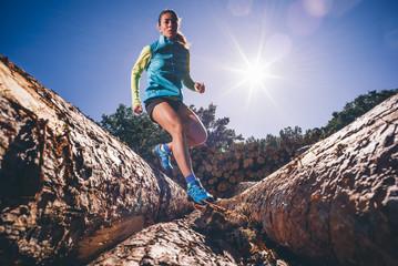 Woman running on the mountain.