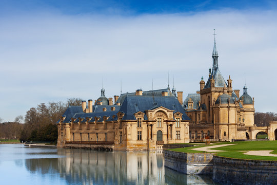 Fairytale Chateau de Chantilly at sunny day