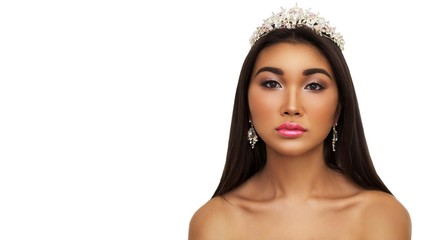 Beautiful young woman brunette long hair pink crown on his head, dark skin, Asian on white isolate background. Clean well-groomed skin, Spa, cosmetics, make-up, fashion concept