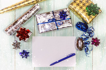 Christmas composition with gifts, hands writing a letter