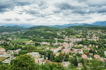 Panorama on the city of Aubenas in the Ardeche region in France with in the background the Ardeche mountains