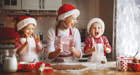 happy family mother and children  bake cookies for Christmas