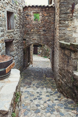 The narrow street in the picturesque village of Lanas in the Ardèche region