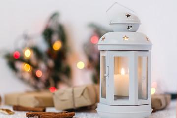 white lantern on white background with lights garlands