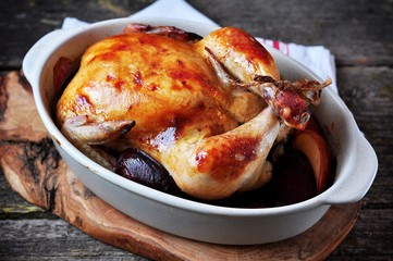 Delicious baked chicken with apples and plums.