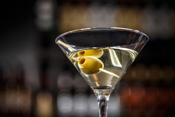 Martini cocktail with green olives
