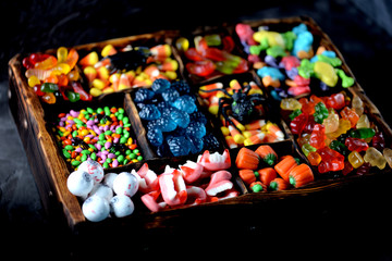 Different candy  -  frogs, bears, worms, pumpkins, eyes, seeds in the glaze, jaws, pumpkins for Halloween.