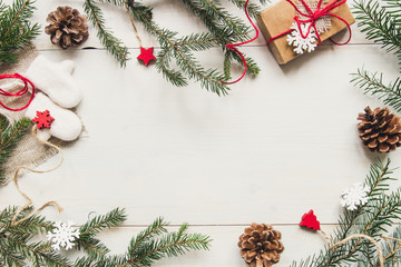 Christmas background. Christmas decoration with fir branches and gift on the wooden white table.