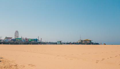 Santa Monica pier in Los Angeles. California. Large beach by the pier.