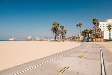 Beautiful morning sunrise lights at the Venice beach in Los Angeles. Bicycle lane by the beach.