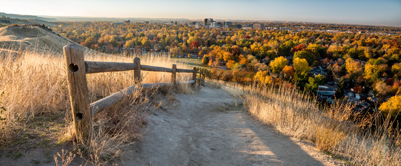 Foot path leads through the foothills over Boise Idaho in the fall Wall mural