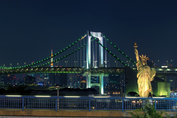 night scene of rainbow bridge important traveling destination in odaiba harbor tokyo japan