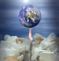 Man trying to hold Earth up to stop it from drowning in massive pile of recyclable products showing environmental struggle to stop pollution from destroying planet. Some elements provided by Nasa.