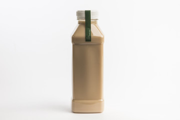 Tasty cocoa milk in plastic bottle on the white background. Organic. Latte, mocha, coffee. Big size bottle.