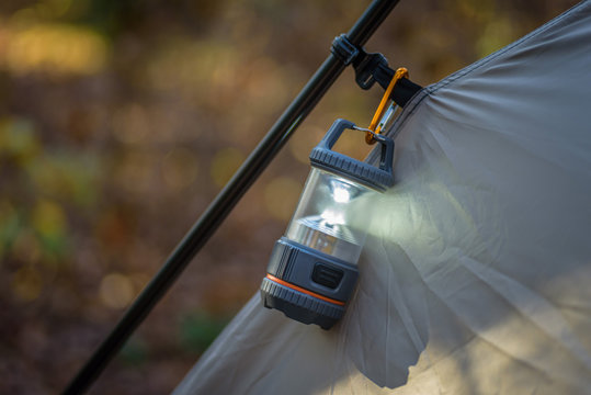 closeup of tent and lantern in fall
