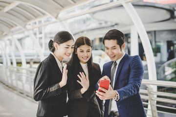 Selfie business partners on smartphone.