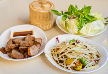 Papaya salad with pickled fish sauce, This dish eat with sticky rice, grilled pork and fresh vegetable, Thai food
