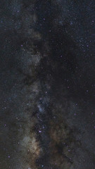 Starry night sky, Panorama Milky way galaxy with stars and space dust in the universe, Long exposure photograph, with grain.