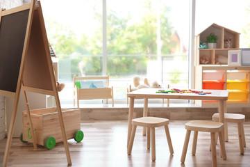Beautiful interior of game room in kindergarten