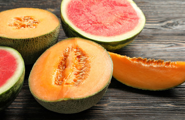 Fresh ripe melons and watermelon on wooden background