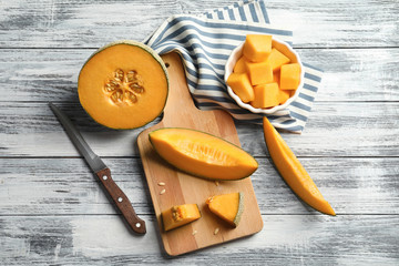 Composition with sliced melon on wooden background