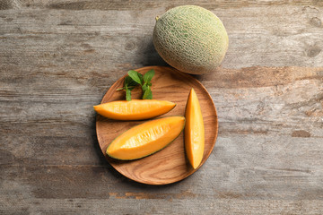 Composition with fresh ripe melon on wooden background