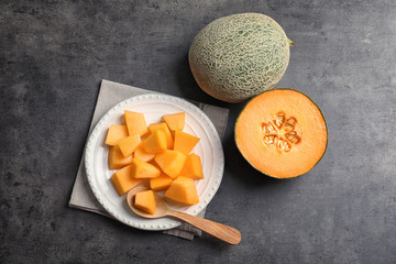 Composition with fresh ripe melon on grey background