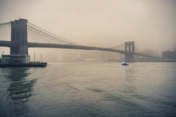 Wall Mural - Brooklyn bridge at foggy rainy evening, New York City