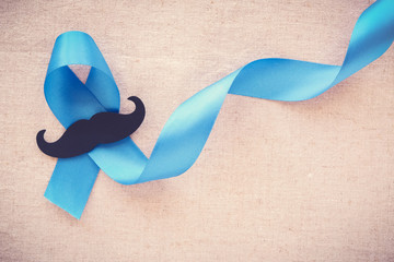 Light blue ribbons with mustache , Prostate Cancer Awareness, Men health awareness, Movember month