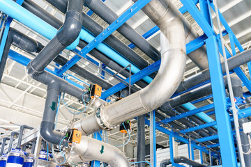 new plastic pipes and colorful equipment in industrial boiler room