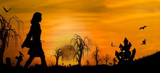 Halloween girl silhouette on graveyard near castle