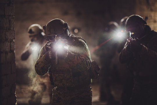 rangers during the military operation with laser sights and lanterns.