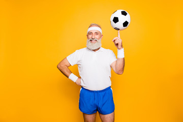 Bodycare, healthcare, weight loss, pride, strength, leadership, motivation, happiness, authority, gym concept. Cool funny modern competetive pensioner, leader, champion plays with ball