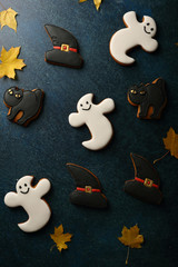 Halloween Ghost cookies composition on blue