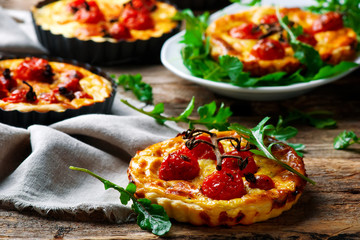 roasted cherry tomato and  goat's cheese quiche.