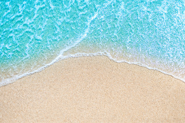 Sea Beach and Soft wave of blue ocean.  Summer day and sandy beach background.