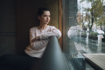 Girl sadly thoughts and looks at window