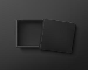 Opened black empty gift box on dark background.