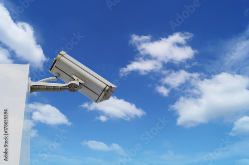 closed circuit camera on top of building on blue sky and white cloud