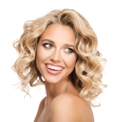 Wall Mural - Blonde woman with curly beautiful hair smiling on white background. Isolated.
