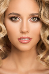 Wall Mural - Blonde woman with curly beautiful hair. Close up portrait.