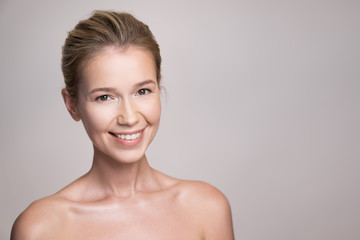 Beauty portrait of attractive middle age blonde woman with perfect skin.