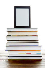 Black picture frame on stack of books