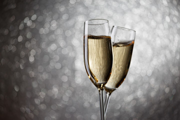 Festive image of two wine glasses with sparkling champagne