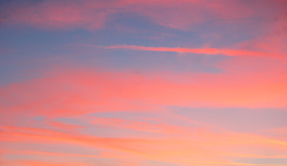 Wall Mural - Red sky with blue clouds